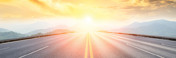 Photo of road with sunshine ahead