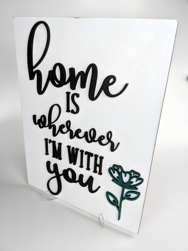 """Wooden Sign with white background that reads """"Home is Wherever I'm With You"""" with teal flower"""