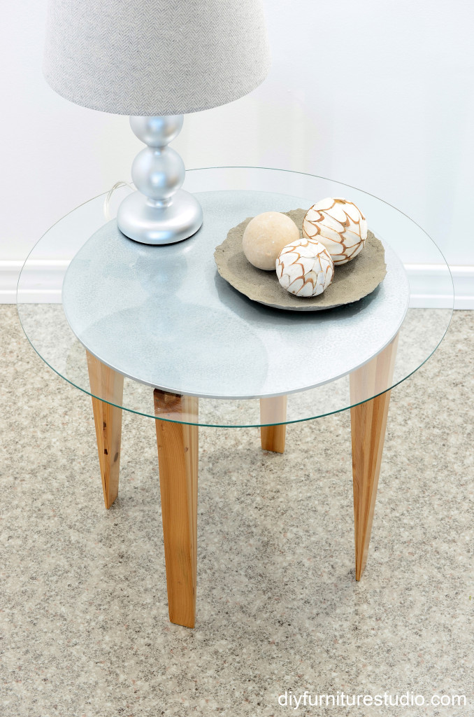 retro style round side table with tapered wood shim legs top front view