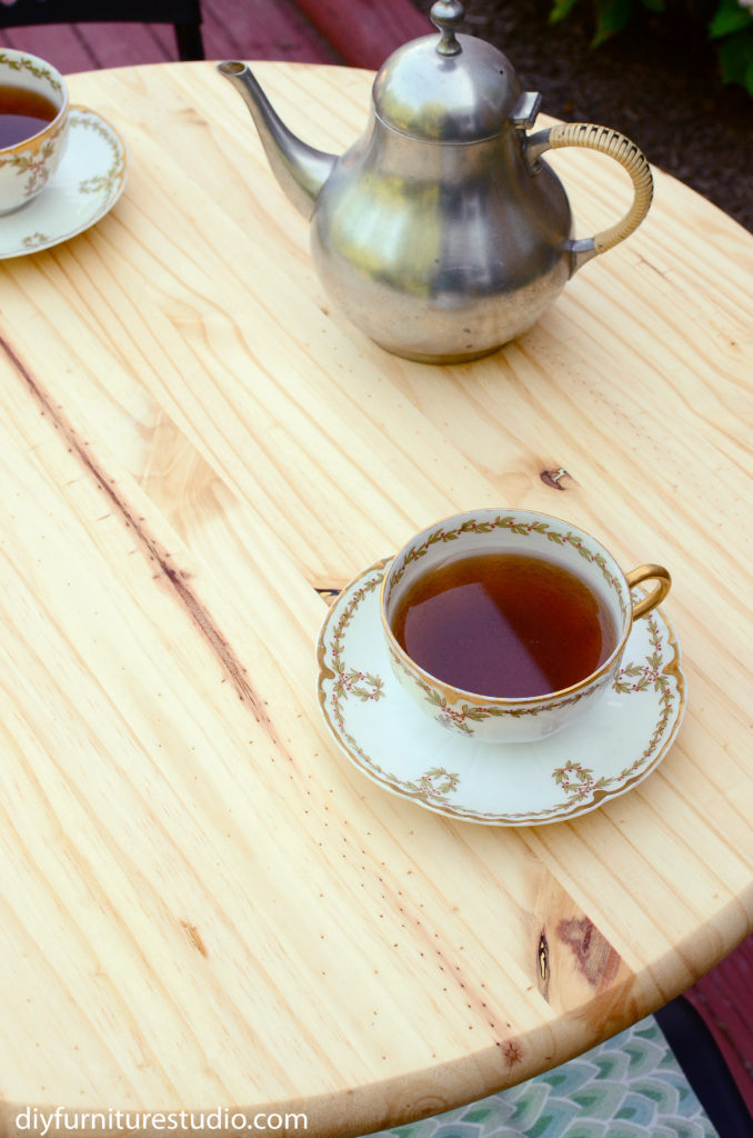 pine table top and interesting wood grain and knots with tea set