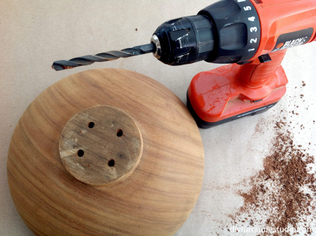 DIY bistro tables drilling holes in bowl