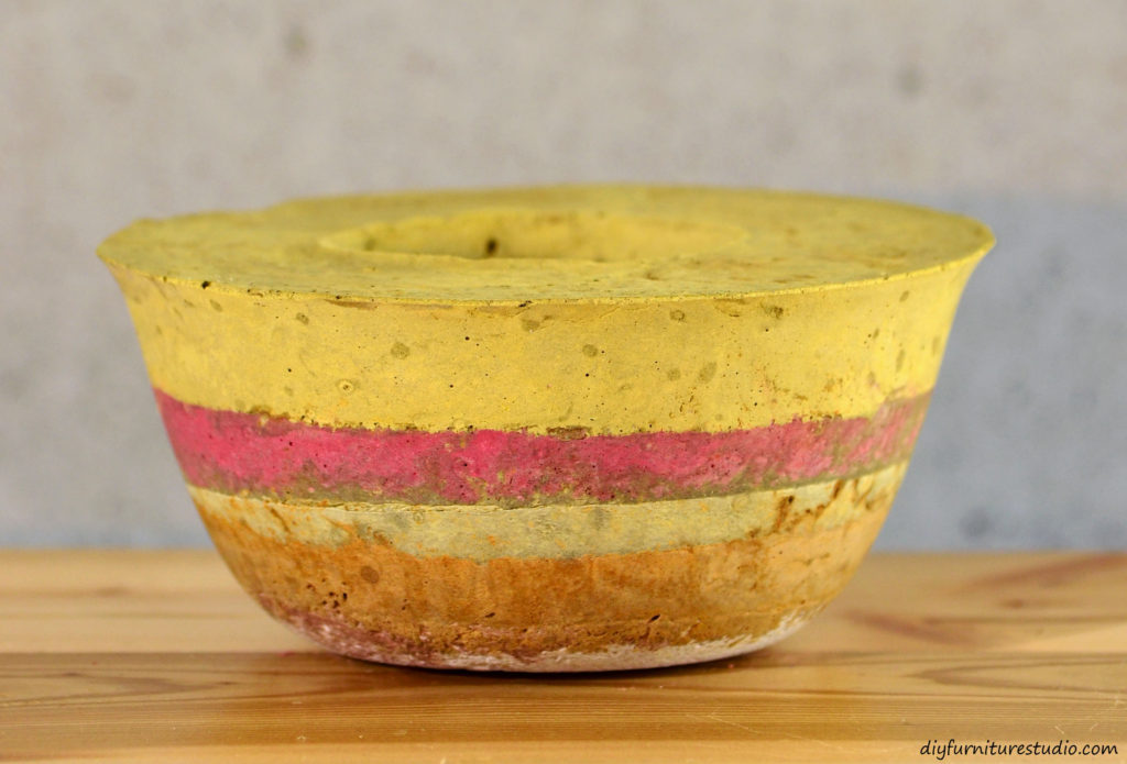 Multicolor DIY cement candle holder tinted with latex paint. See diyfurniturestudio.com for tutorial.