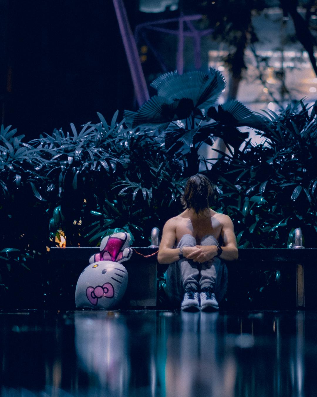 portrait of zaccy meditating in the rain