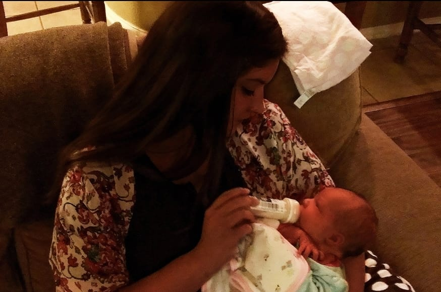 Malia Holding and Feeding Our New Baby