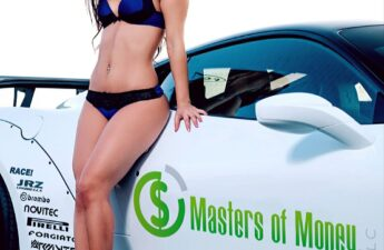 Amber Posing On Masters of Money LLC's Race Car
