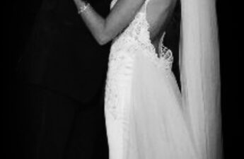 Malia and MJ Wedding Day Kiss Black and White Photo