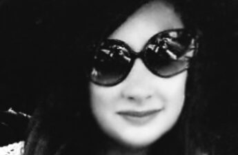 Malia May Johnson Big Hat Big Sunglasses Black and White Photo