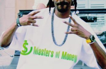 Snoop Dogg Wearing a Masters of Money LLC Logo T-Shirt