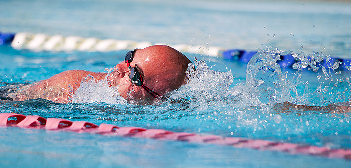 Jason Caswell, an Air Force Wounded Warrior athlete, swims laps during the fourth day of the Warrior Games training camp at Eglin Air Force Base, Fla