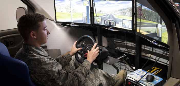 William Schweitzer, 96th Logistics Readiness Squadron, demonstrates the unit's driving simulator.