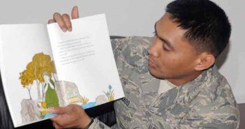 United Through Reading reader sharing book