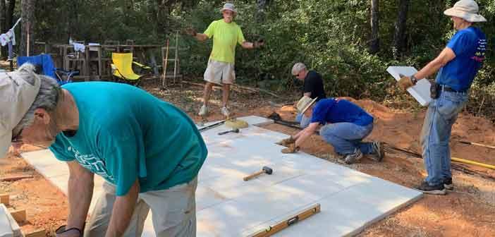 niceville kiwanis club members building patio