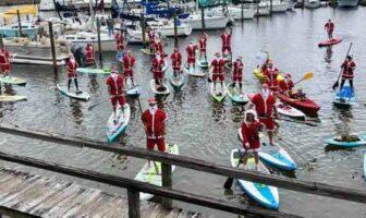santas on paddleboards at Bluewater Marina in Niceville 2019