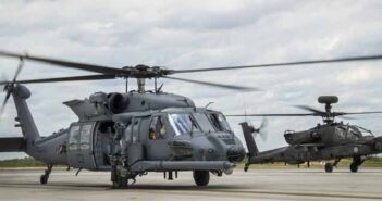 HH-60W Jolly Green II taxies in followed by an AH-64 Apache May 19 at Eglin Air Force Base, Fla.