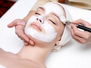 Woman receiving facial mask for European Facial