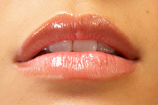 glossy lips with teeth showing