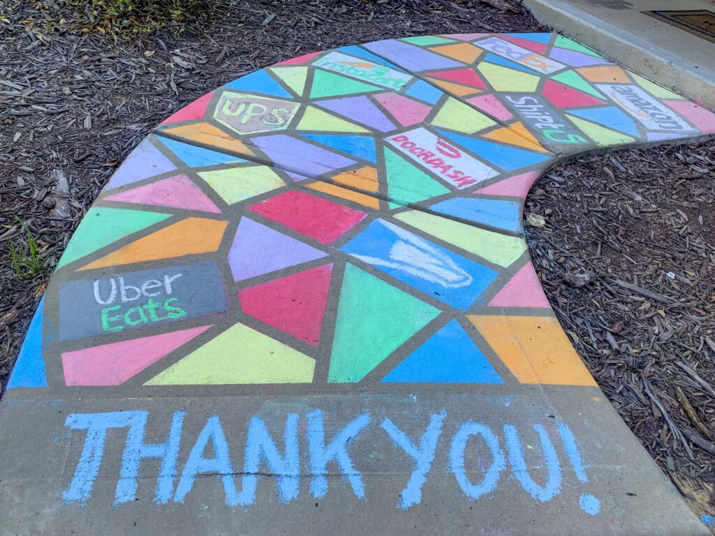 Chalk thank you sign on sidewalk. Use your driveway or sidewalk as a canvas. With so many people walking these days this is a great opportunity to spread good cheer and gratitude with hopeful messages of encouragement and thanks.
