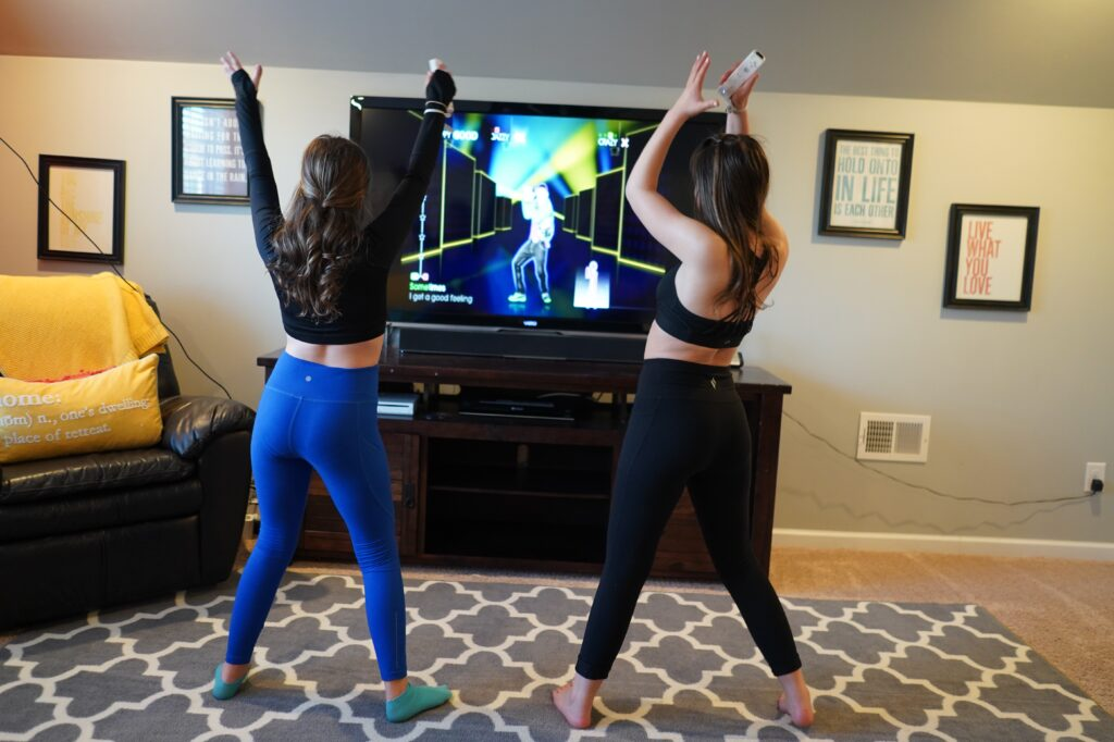 Girls play Just Dance on Wii. There's nothing like some upbeat tunes to shake up a dull day. So crank up the volume and burn some of that bouncing-off-the-walls energy with a family dance party.