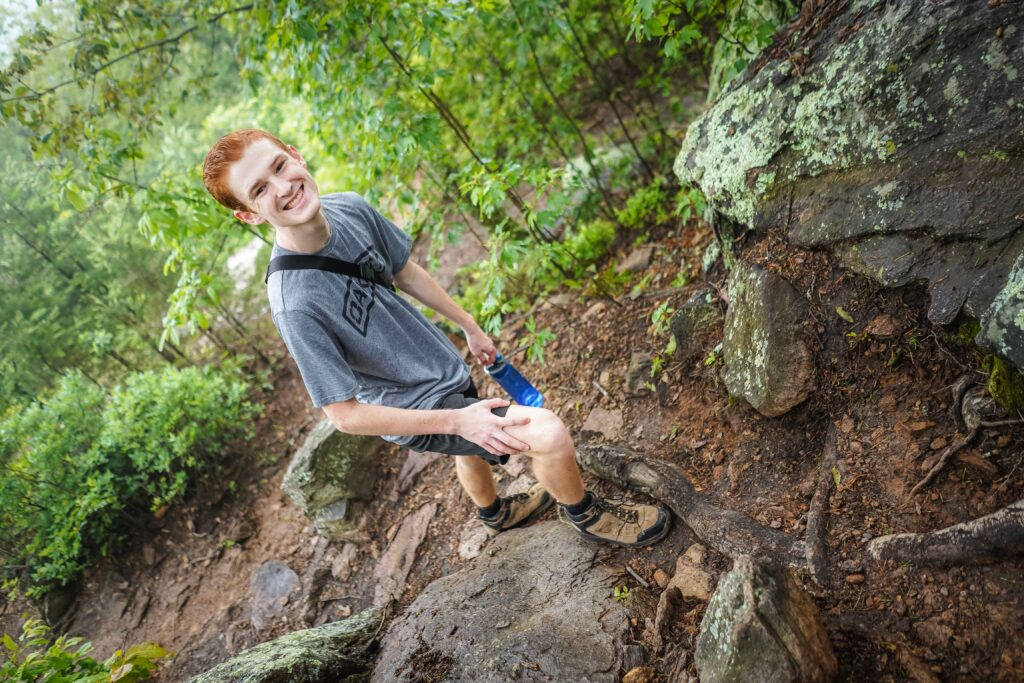 Teen boy pictured hiking on trail. Not only is hiking one of the safest outdoor activities you could enjoy this summer its good to get out in nature. Find a local conservation area or greenway in your area and go for a nice, long family walk.