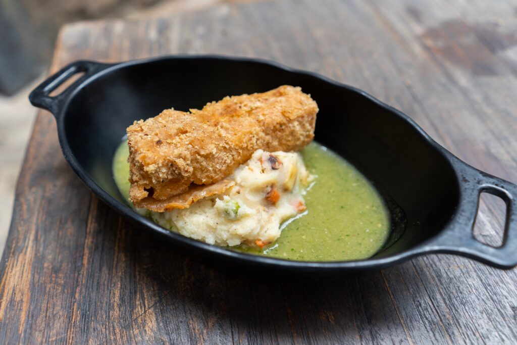 Fried Endorian Tip-yip – rectangular-shaped crispy chicken served with roasted vegetable potato mash and herb gravy.