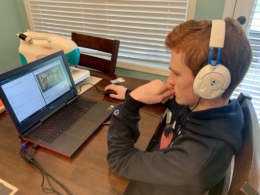 Teen boy uses lap top for virtual visit. Take virtual tour of your favorite museum or one that you have never visited before..