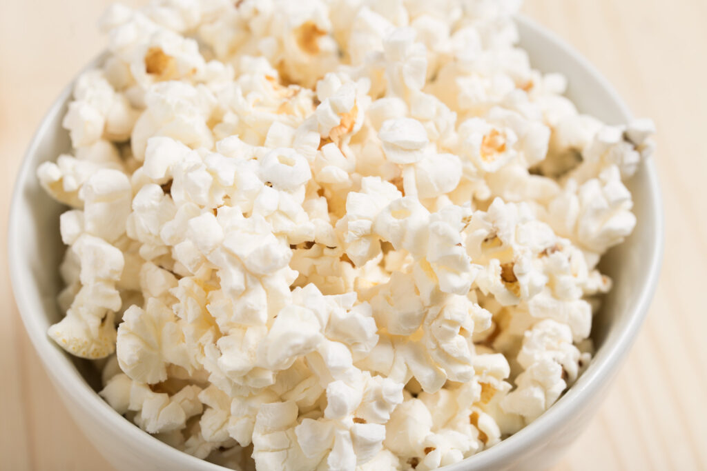 Bowl of popcorn. See a Broadway show from home this summer. - Safe Summer Bucket List – 100 Ways to Have Fun This Summer While Social Distancing
