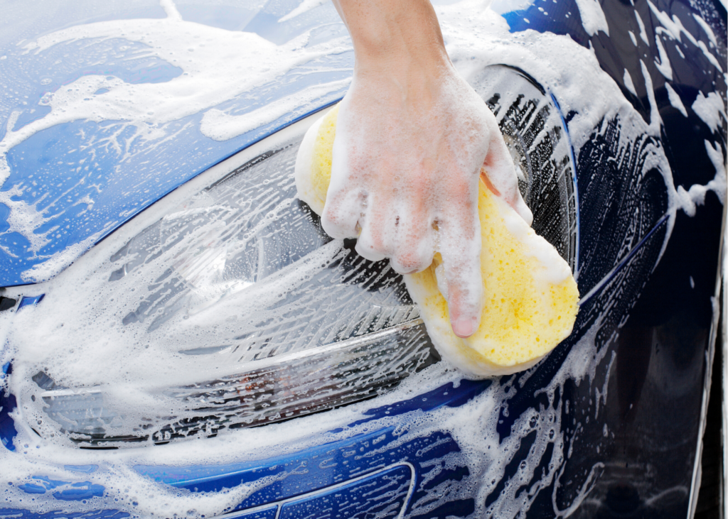 Close up image of hand washing car. Another chore you could offer up for some extra cash is washing the family vehicles in your driveway. Fill up a bucket with some soap and water, give the kids a sponge and hose and let them have at it.