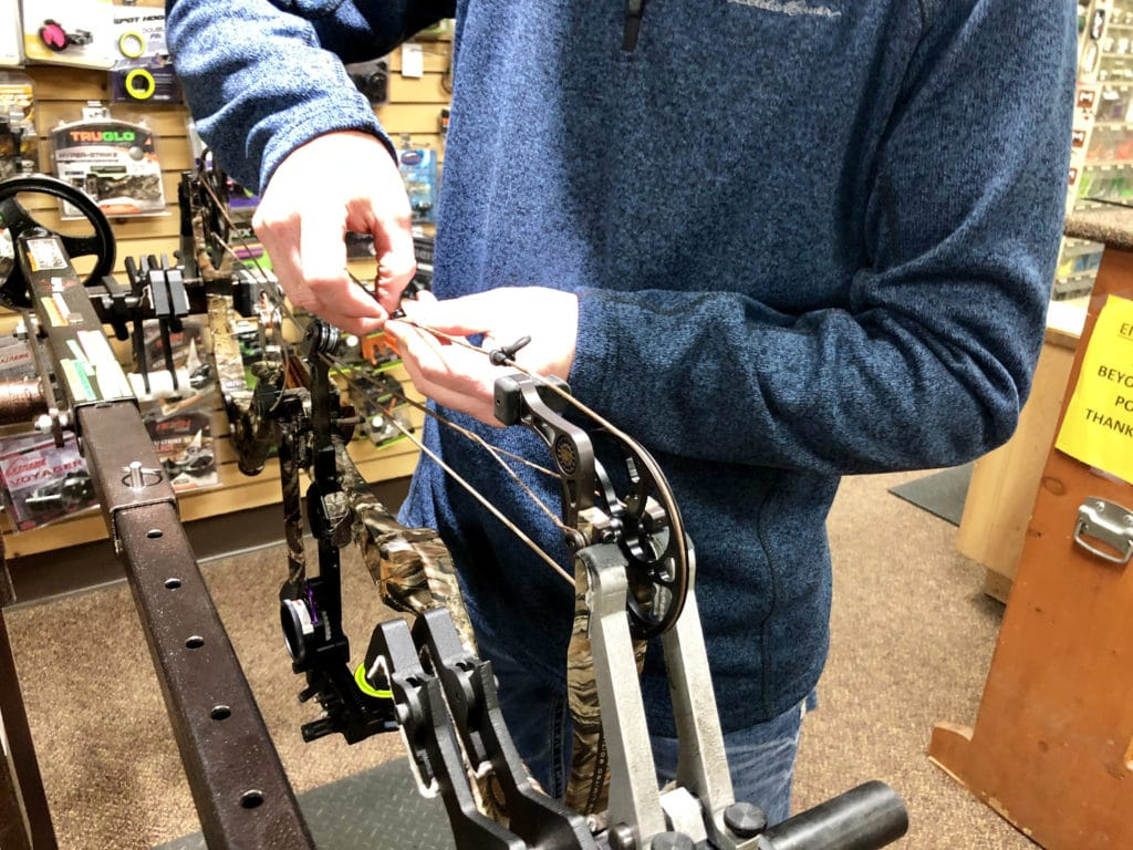 servicing a compound bow on a bow press