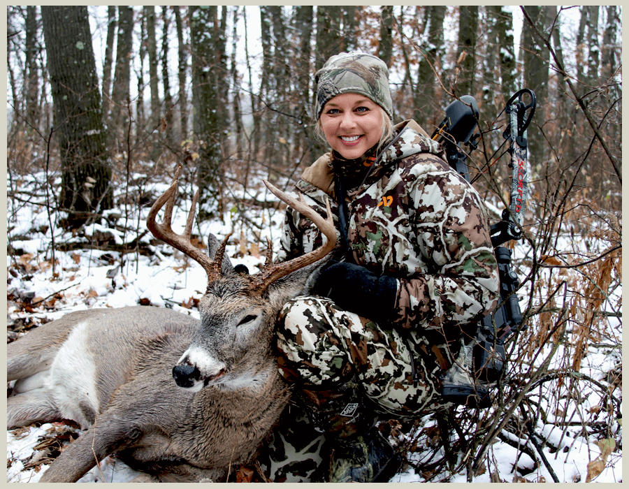 A women hunter with whitetail deer