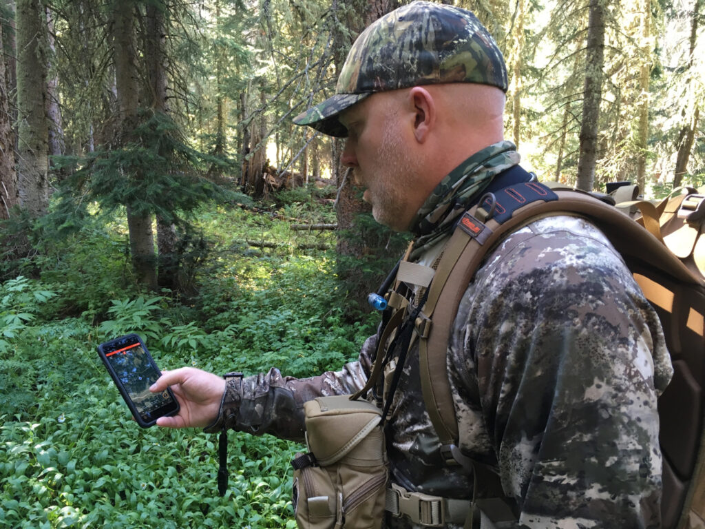 A hunter using the onX hunt app.