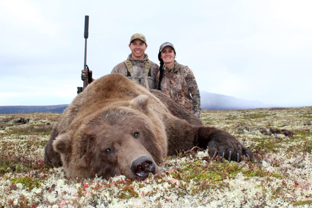 Hunters with an alaskan bear bear