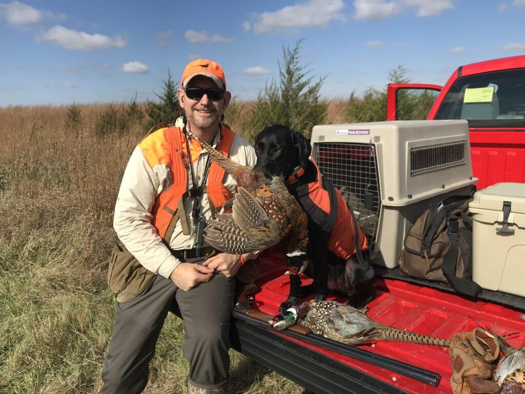 Matt Kucharski and his lab Nellie pheasant hunting