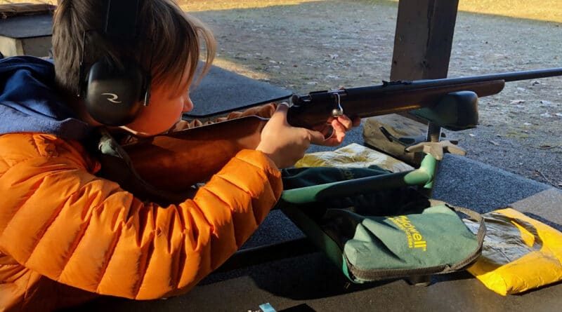 boy shooting a 22 rifle