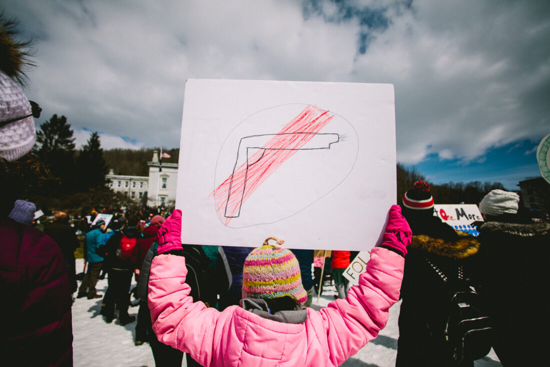 A girl holds a sign of a gun at the March for Our Lives March in Montpelier, VT