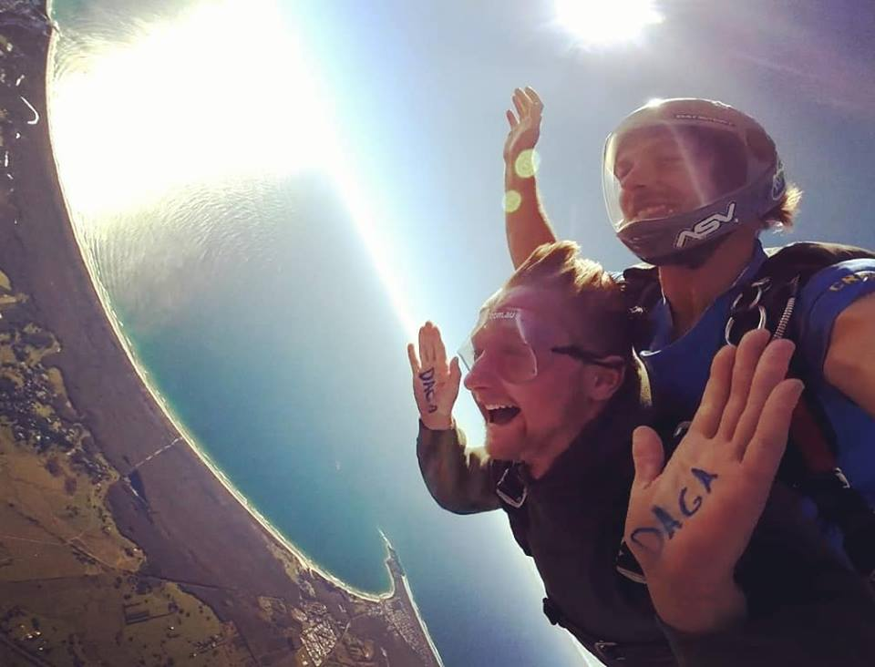 A happy man skydiving in Byron Bay, Australia