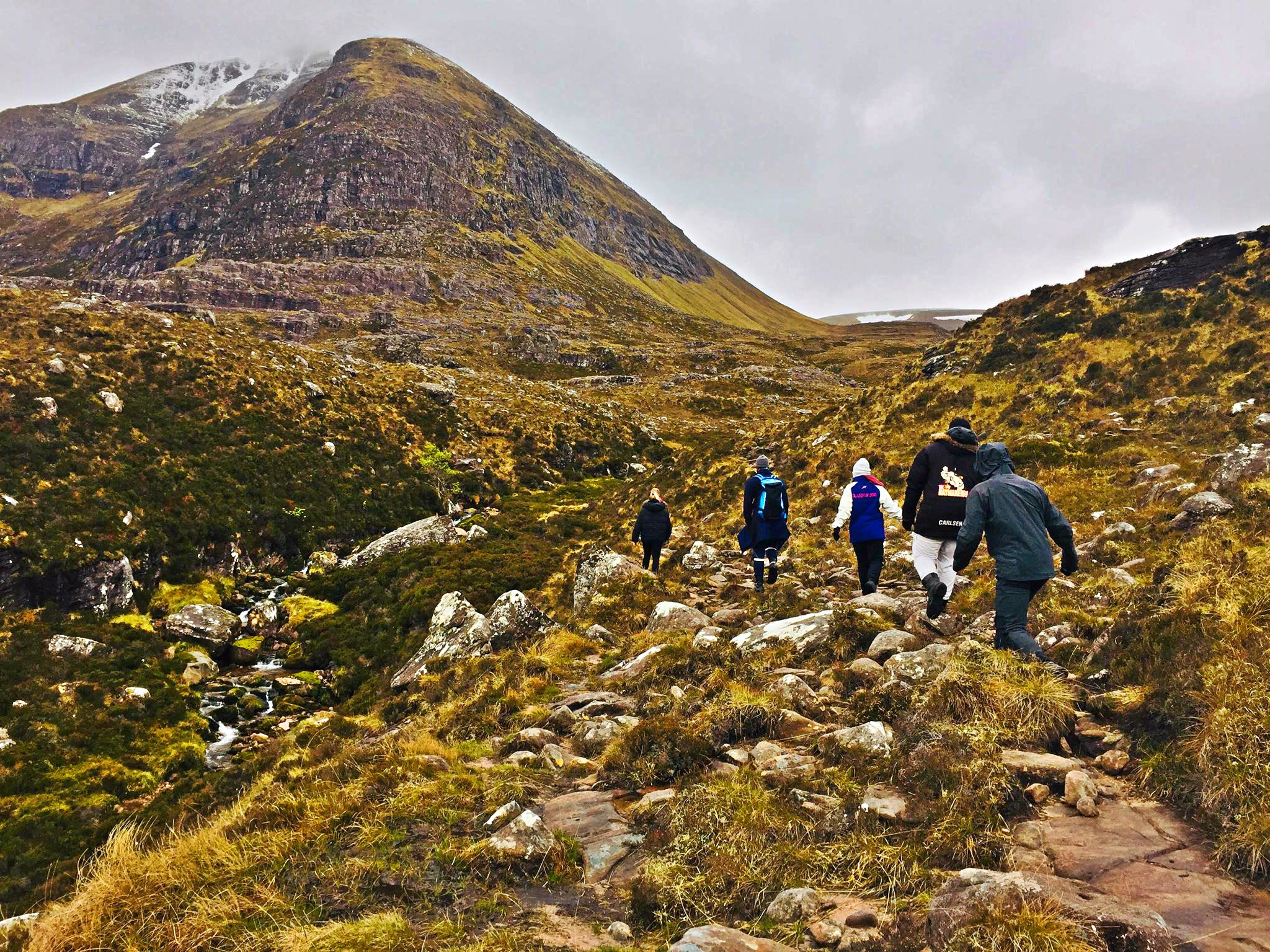 People hiking the An Teallach in Scotland