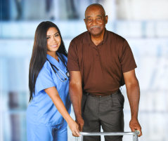 elderly man with a female nurse