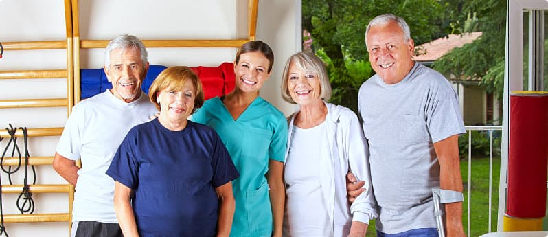 group of elderlies with a physical therapist