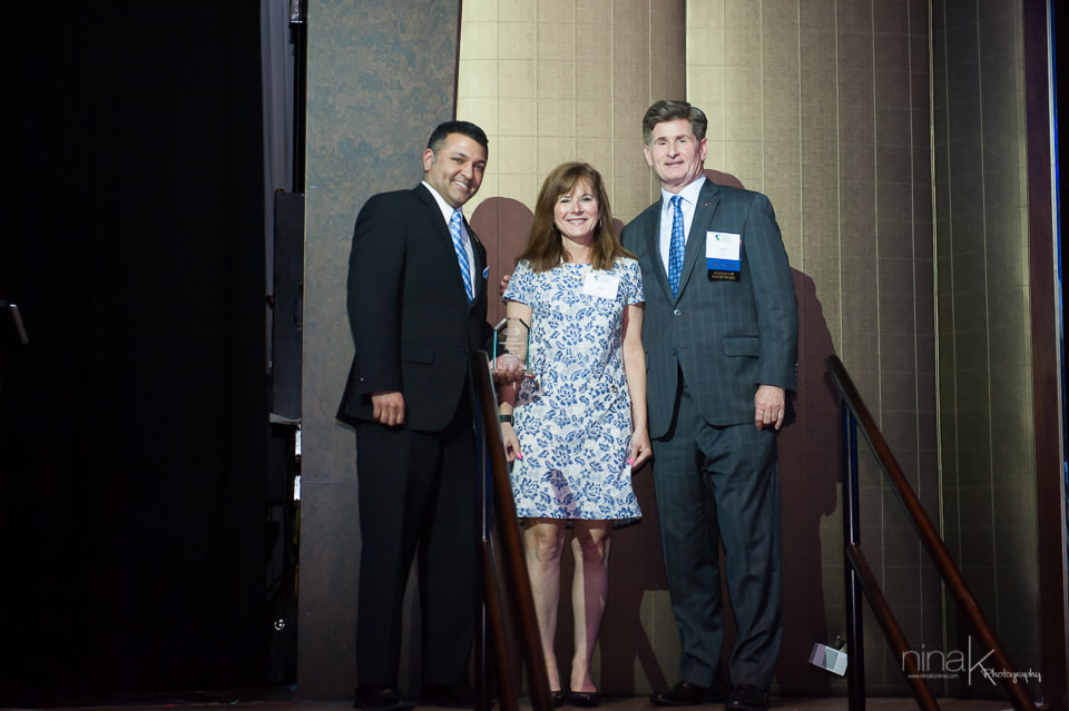Beth receiving her award from President & CEO, Raj Kudchadkar, and Chairman of the Board, Jeff Armiger