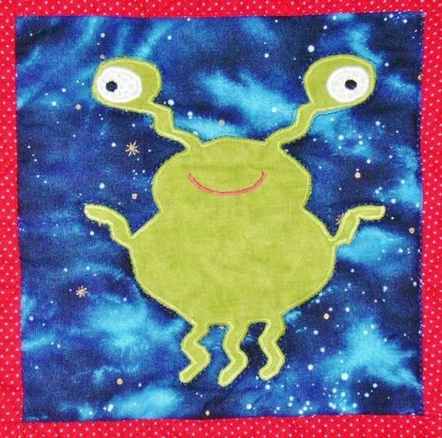 green alien applique block