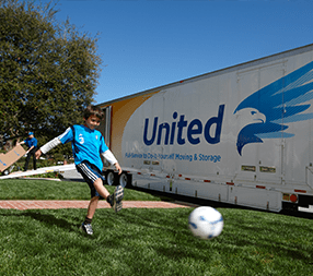 United Moving Van in front of residential yard