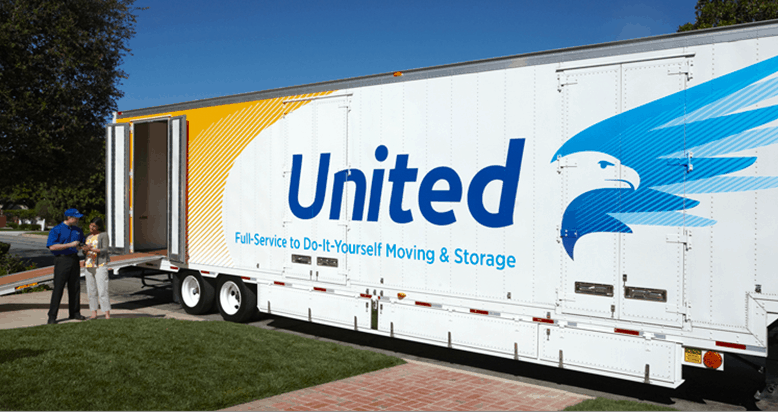 United Van Lines truck with mover talking to customer
