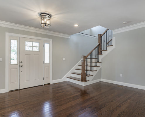 Hardwood floor entryway with view of L-Shaped staircase