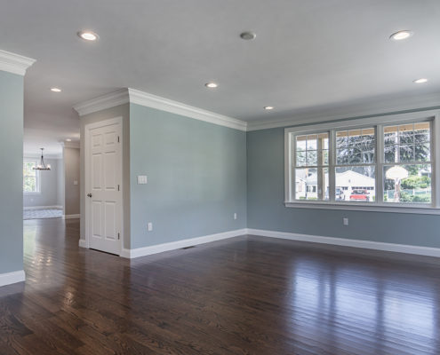 Spacious custom room with hardwood flooring and unique windows resulting in plenty of natural light