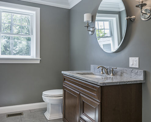 Stylish bathroom with dark wood countertop and stainless steel sink