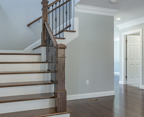 View from entryway overlooking L-shaped staircase