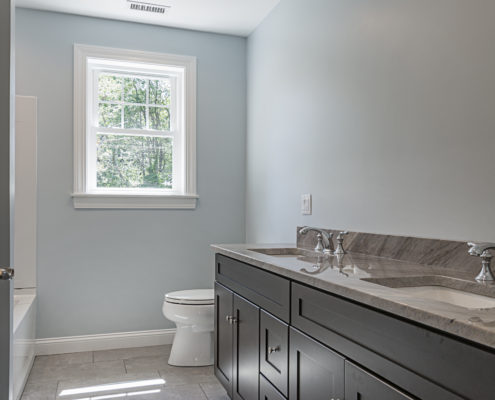 Bathroom with his and hers sinks and a deep corner tub