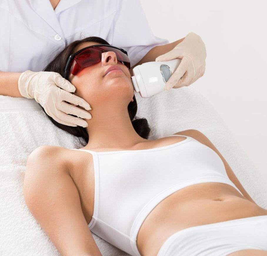 laser hair removal on full face client receiving epilation