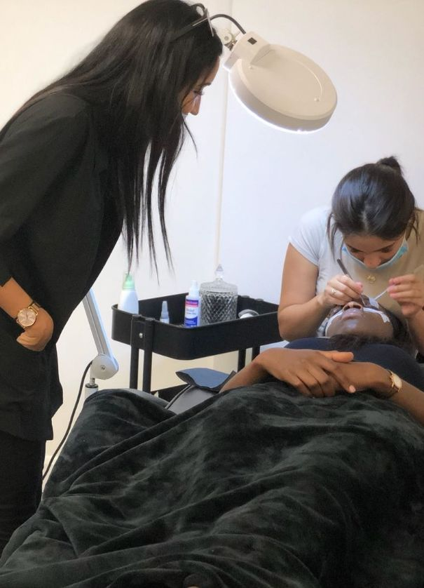 eyelash extensions training in more during class student doing russian volume on practice model