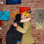 Cammy Davis hugging the Poet Pistachio